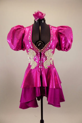 Pink iridescent pouf sleeved peplum tailcoat had crystal accents & large white beaded appliques.Beneath is pink crystaled bra and patterned fuchsia briefs. Front