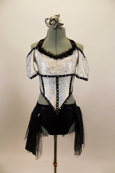 Armor themed white half top has drop cap sleeves. Front of the crystaled bodice comes to point  Black brief & skirt has panels of tulle & sequined sheer. Front