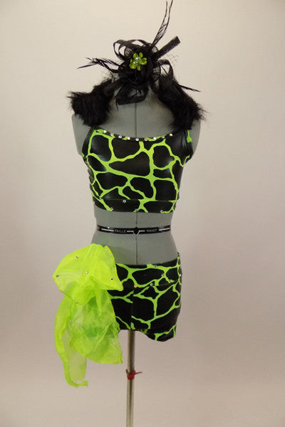 Neon green & black animal print costume has half top with black fur collar. Matching shorts have large lime green organza bow on right hip with crystal accents. Front