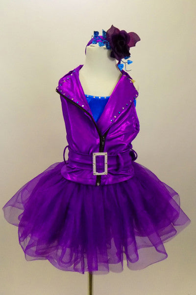 Purple metallic moto-style jacket neckline,zip-front & belt. Comes with turquoise leotard & fluffy purple tricot skirt. Has matching headband & gauntlets. Front