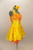 Orange & yellow paillettes, feathers & crystals adorn yellow satin dress with halter neck, skirt with yellow base on orange petticoat & matching hair accessory. Right side