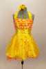 Orange & yellow paillettes, feathers & crystals adorn yellow satin dress with halter neck, skirt with yellow base on orange petticoat & matching hair accessory. Front