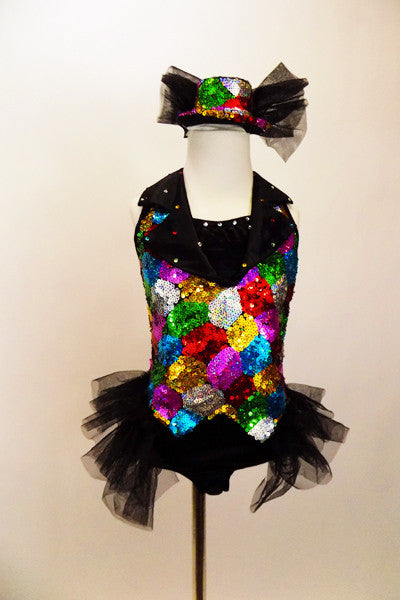 A black satin leotard & attached vest of colourful sequin patches & black satin lapel covered in crystals. Has sparkle tulle bustle & matching sequined top hat. Front