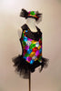 A black satin leotard & attached vest of colourful sequin patches & black satin lapel covered in crystals. Has sparkle tulle bustle & matching sequined top hat. Right side