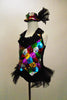 A black satin leotard & attached vest of colourful sequin patches & black satin lapel covered in crystals. Has sparkle tulle bustle & matching sequined top hat. Left side