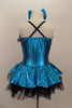 Turquoise holographic square sequined dress has bow tie accent & ruffle. Skirt has layers of black tricot petticoat beneath. Comes with matching shoe & bows. Back