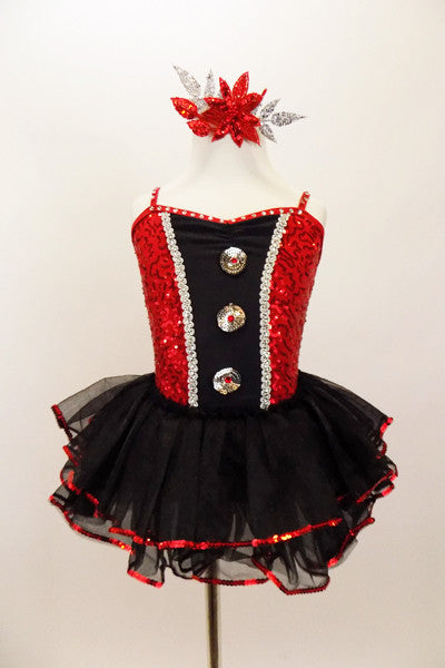 Red sparkle sequin bodice has black satin insert  with sequined-crystal buttons, silver cording & crystalled straps. Has attached sequined ruffle skirt. Front