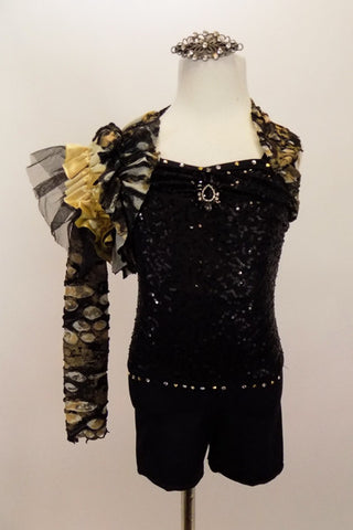 Black biketard has crystal neck & waist. Has stone pattern asymmetrical shrug with gold satin & black tulle shoulder ruffle. Comes with matching hair accessory. Front