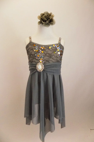 Empire waist lyrical dress has jagged mesh skirt & silver sequined lace bust. Has crystaled straps & sash with large crystal-opal brooch & matching hair piece. Front
