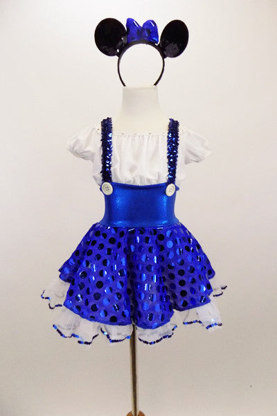 Cap sleeved dress has crystaled blouson bodice, wide waistband, 2  white buttons & suspenders attached to polka dot blue skirt.& white sequined petticoat. Come with mouse ear headband with bow. Front