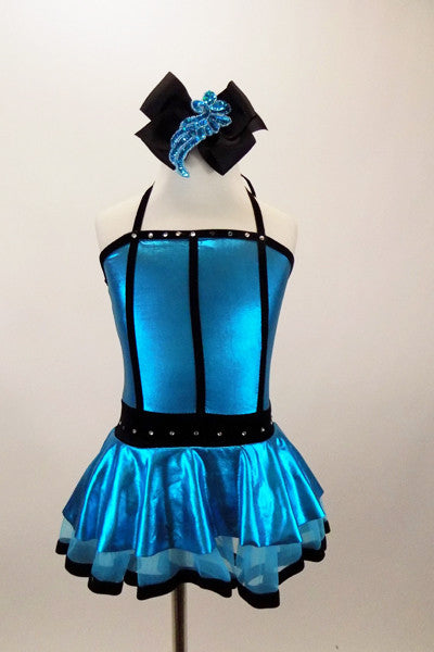 Turquoise metallic halter dress has black vertical piping & waistband with crystals. There is an attached black velvet edged petticoat skirt. Has matching hair accessory. Front