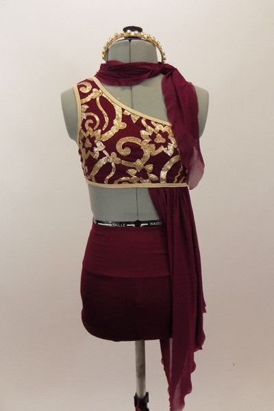 Maroon costume has golden brocade pattern, gold binding and an attached stretch-mesh scarf & asymmetrically draped skirt. Has high-waisted shorts & hair accessory. Front