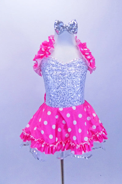 Silver sequined leotard dress has attached skirt with bright pink satin polka dot overlay on white ruffled tricot. Has bow at the back, halter ruffle & hair bow. Front