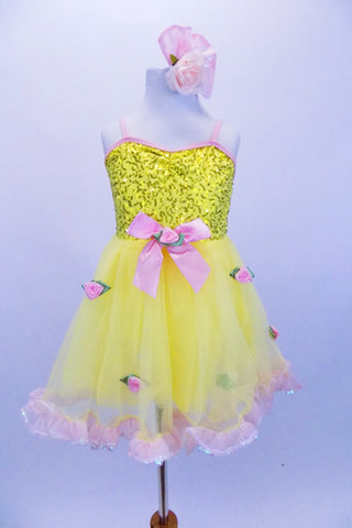 Yellow tutu dress has sequin bodice with satin bow & rose at front. Skirt is layers of yellow tricot with  pale pink satin rosettes. Has matching hair accessory. Front