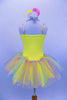 Sequin mesh overlays front bodice of  camisole leotard with silver braid trim. Rainbow sparkle tulle rests on yellow tricot tutu. Roses accent waist and hair. Back