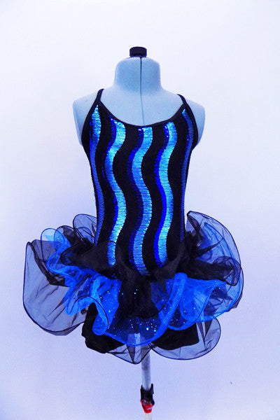 Blue sequin wave pattern covers the bodice of camisole biketard. Three-tiered glitter tulle skirt has a black & blue curly hem. Comes with top hat & gloves. Front