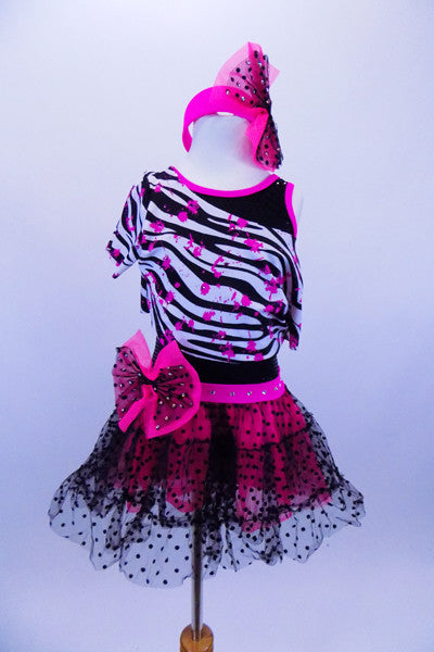 Tank biketard has sparkling black bodice with cerise binding. Attached skirt is black lace & cerise petticoat. Comes with zebra splatter print top & headband. Front