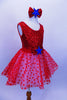 Red tank leotard dress has sequined bodice with large bow with blue star applique, Skirt is layers of white tricot with red polka dot mesh & matching hair piece. Right side