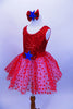 Red tank leotard dress has sequined bodice with large bow with blue star applique, Skirt is layers of white tricot with red polka dot mesh & matching hair piece. Left side