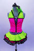 Sequined zebra-print  biketard has separate pink & lime zippered vest. The attached cerise pink & lime layered ruffle skirt has polka dot ribbon accent. Comes with matching hair accessory. Front