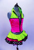 Sequined zebra-print  biketard has separate pink & lime zippered vest. The attached cerise pink & lime layered ruffle skirt has polka dot ribbon accent. Comes with matching hair accessory. Right side