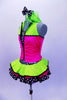 Sequined zebra-print  biketard has separate pink & lime zippered vest. The attached cerise pink & lime layered ruffle skirt has polka dot ribbon accent. Comes with matching hair accessory. Left side