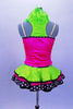 Sequined zebra-print  biketard has separate pink & lime zippered vest. The attached cerise pink & lime layered ruffle skirt has polka dot ribbon accent. Comes with matching hair accessory. Back
