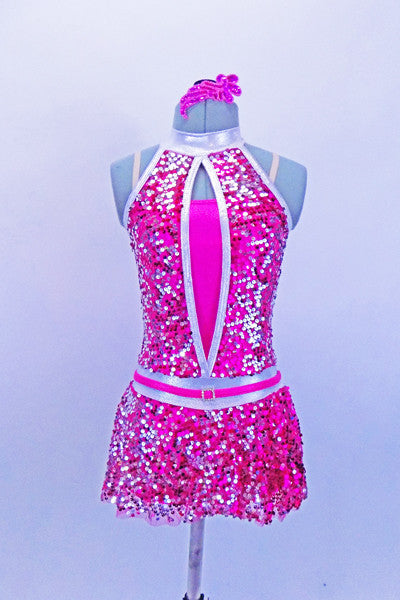 Fuchsia metallic biketard base has silver halter collar & attached, silver-fuchsia fully sequined peek-a-boo bodice & skirt. Has matching hair accessory & belt. Front