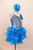 Hologram sequins cover stretch satin bodice of turquoise ruffled camisole dress. Jeweled rosettes accents the left shoulder and hair matching hair accessory. Right side