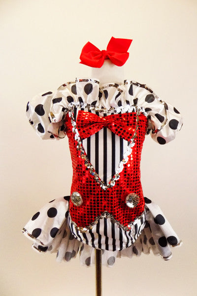 Black & white striped leotard has red sequined vest with silver buttons & red bow tie. Attached polka-dot bustle skirt matches pouf sleeves. Has red hair bow. Front