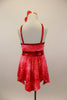 Marbled red-crimson tunic has halter collar with red binding & ring accent at front that attaches to back cross straps,.Comes with belt, shorts & hair accessory. Back