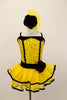 Yellow sequin leotard has black velvet accents with crystals. Black satin rosettes accent the waist & hair accessory. Has ruffle layer skirt with black trim. Front