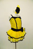 Yellow sequin leotard has black velvet accents with crystals. Black satin rosettes accent the waist & hair accessory. Has ruffle layer skirt with black trim. Right side
