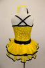 Yellow sequin leotard has black velvet accents with crystals. Black satin rosettes accent the waist & hair accessory. Has ruffle layer skirt with black trim. Back
