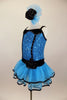 Blue sequin leotard has black velvet accents with crystals. Black satin rosettes accent the waist & hair accessory. Has ruffle layer skirt with black trim. Left side