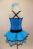 Blue sequin leotard has black velvet accents with crystals. Black satin rosettes accent the waist & hair accessory. Has ruffle layer skirt with black trim. Back