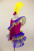 Magenta camisole biketard has crystals & feather accents. Asymmetrical  purple & yellow ruffle crosses the bodice & open front bustle. Has yellow hair feather. Left side