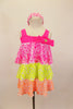 Three tiered, ruffle biketard is neon pink, yellow and orange sequin stretch mesh. The neon pink neckline has a jeweled bow. Comes with sequined hair band. Front