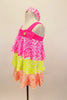 Three tiered, ruffle biketard is neon pink, yellow and orange sequin stretch mesh. The neon pink neckline has a jeweled bow. Comes with sequined hair band. Left Side