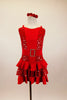 Red leotard dress has red center with silver polka dot sides. Has wide crystal buckle belt & skirt with layers polka dot ruffles. Comes with matching hair accessory. Front
