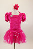 Hot pink stretch satin ruched dress has attached bolero with crystal accents,a  tulle skirt with silver polka dots & pouf sleeves. Comes with hair accessory. Front