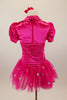 Hot pink stretch satin ruched dress has attached bolero with crystal accents,a  tulle skirt with silver polka dots & pouf sleeves. Comes with hair accessory. Back