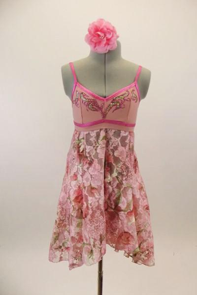 Pale pink bra top has bright pink trim & hand pained design. Brief has matching painted design & attached floral lace skirt that opens at front. Comes with matching floral hair accessory. Front