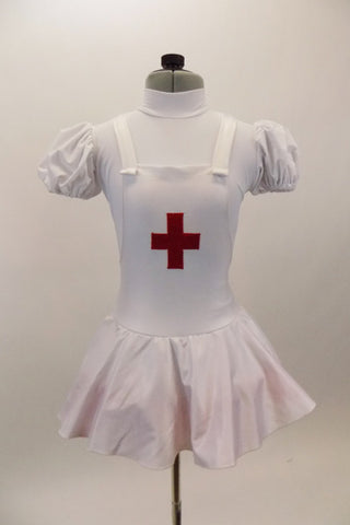 White pouf sleeved nurse's dress had red petticoat & attached pinafore with large red cross on the front. Comes with matching nurse hat. Front