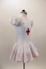 White pouf sleeved nurse's dress had red petticoat & attached pinafore with large red cross on the front. Comes with matching nurse hat. Side