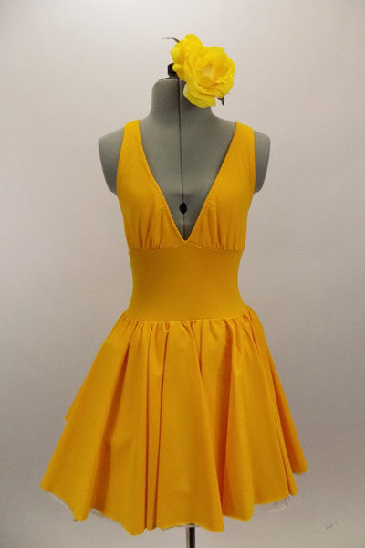 Yellow, halter leotard dress has cross straps and low back. The wide waistband separates bust area & skirt with tulle underlay. Comes with rose hair accessory. Front