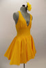 Yellow, halter leotard dress has cross straps and low back. The wide waistband separates bust area & skirt with tulle underlay. Comes with rose hair accessory. Side