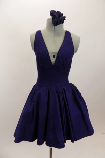 Navy, halter leotard dress has cross straps and low back. Wide waistband separates the bust area & skirt with tulle underlay. Comes with rose hair accessory. Front