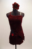 Deep red velvet two-piece costume with red sparkle & metallic accents accents, comes with asymmetrical kerchief top to match shorts. Has flower hair accessory.