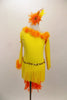 Yellow velvet long sleeved, one shoulder dress has fringe skirt and orange marabou trim. Back has a long orange feather boa tail. Comes with matching hair accessory. Front